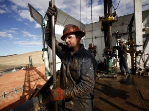 His overalls caked in mud, roughneck Brian Waldner wrestles with pipe as North Dakota's new horizon unfolds around him.